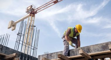 Skilled Construction Laborer Worker At Construction Site