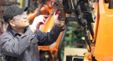Repairman in factory