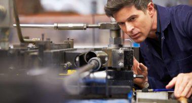 Factory Engineer Operating Hydraulic Tube Bender